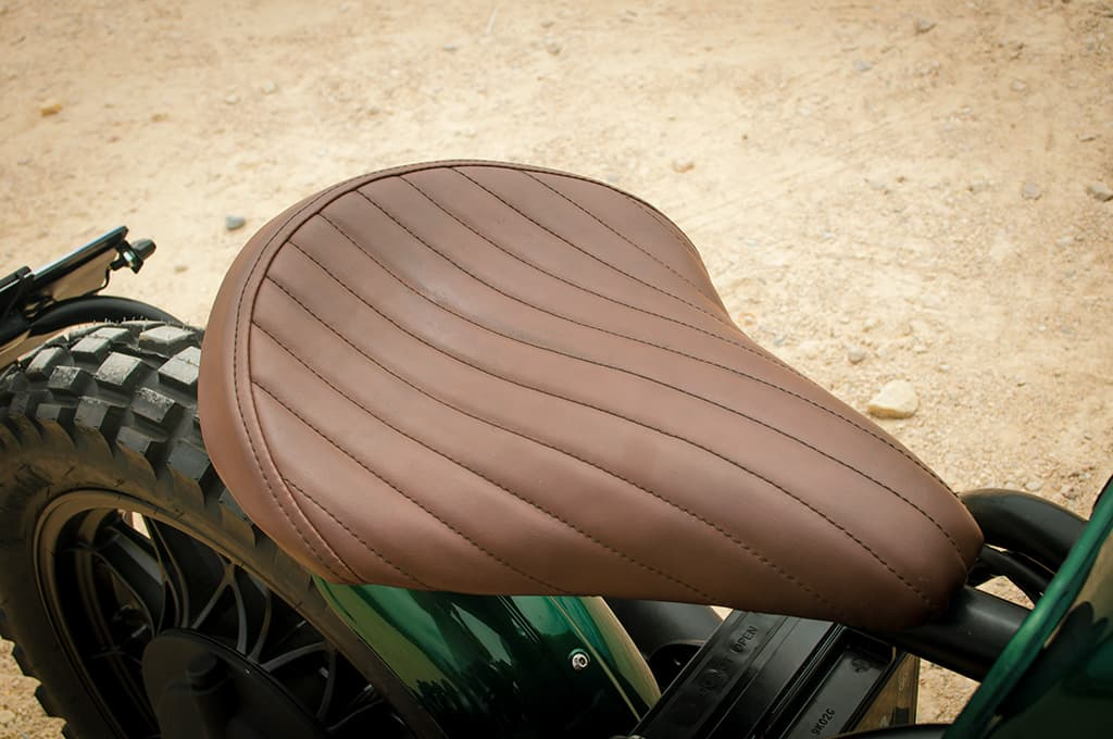 "The seat of this BMW R100 Scrambler  ""Green"" has been hand-upholstered in brown poly leather."