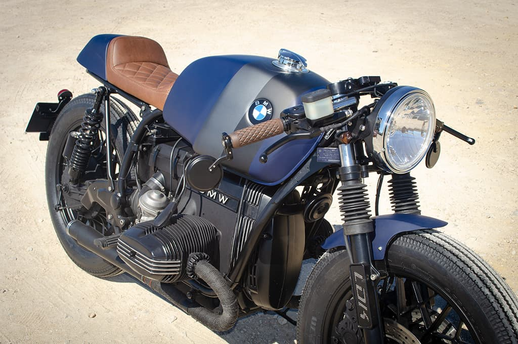 """A closer front left-to-right perspective of the BMW R65 Cafe Racer """"Blue"""" where we can appreciate the matt electric blue of the tank and other elements."""