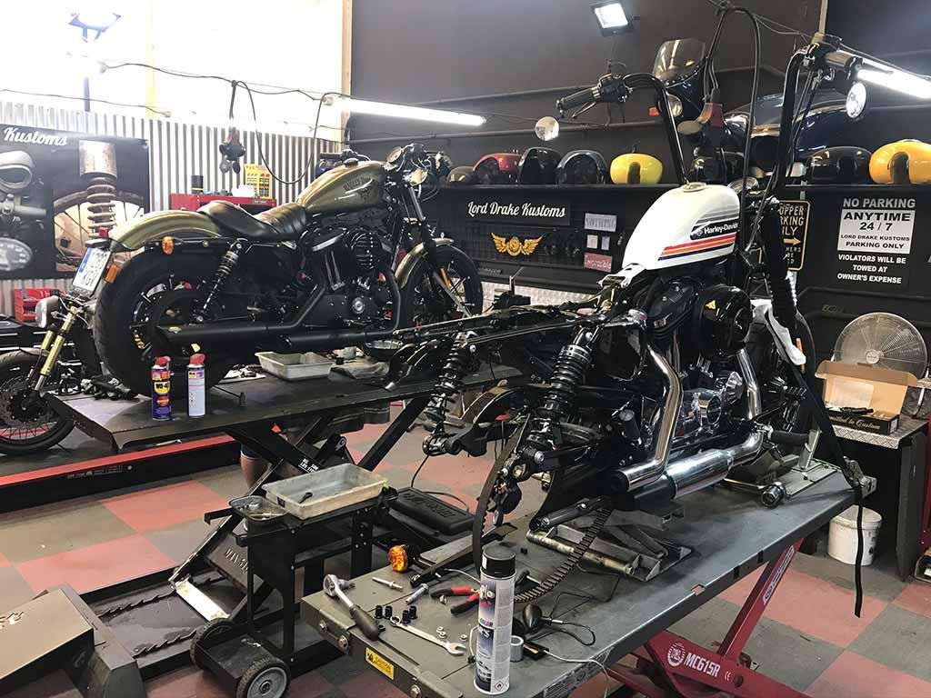 Various Harley Davidsons in Lord Drake Kustoms custom motorcycle workshop