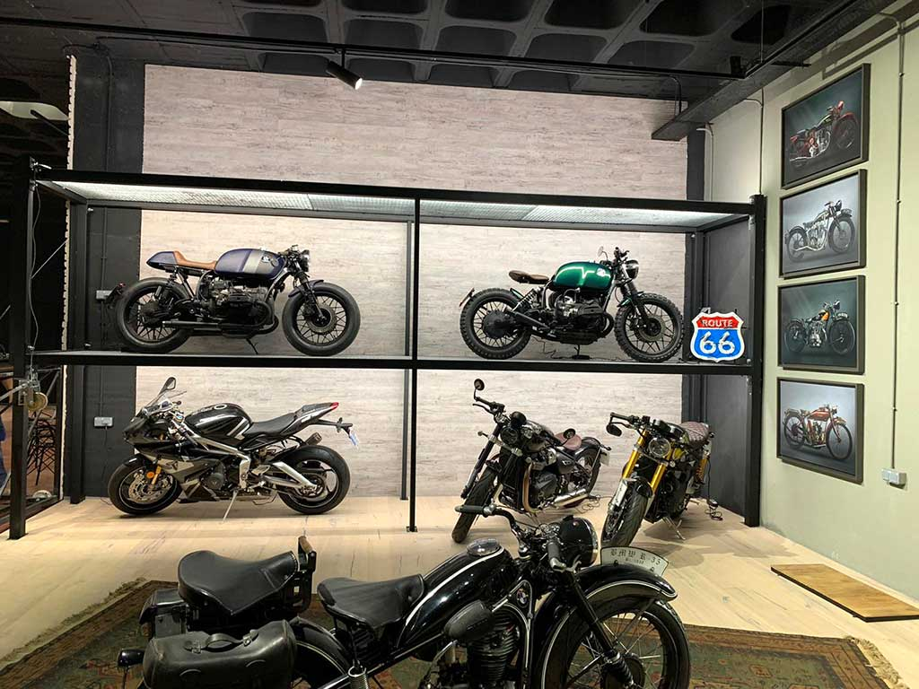 Collection of custom motorcycles in Lord Drake Kustoms workshop in Madrid