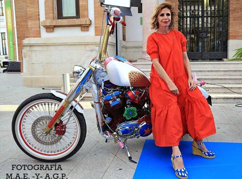 Ágatha Ruiz de la Prada sitting on the Harley Agathizada
